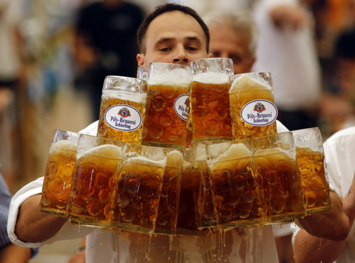german-oliver-stuempfl-competes-to-set-a-new-world-record-for-carrying-one-liter-beer-mugs-over-a-distance-of-131-feet-on-sept-7-struempfl-carried-27-mugs-to-set-a-new-world-record.jpg